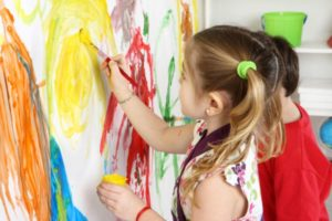 kids-painting-on-wall